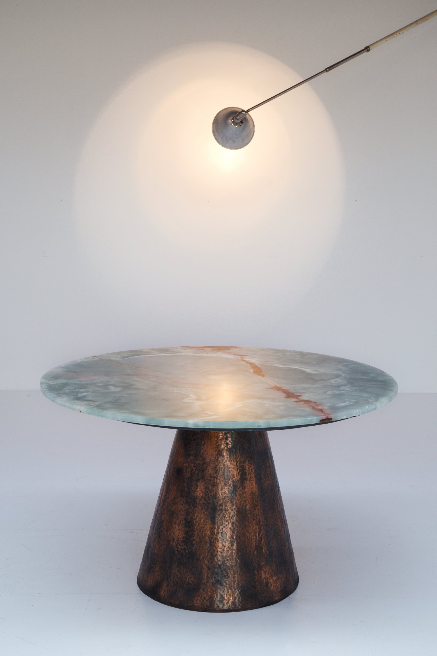 Copper and onyx dining table.