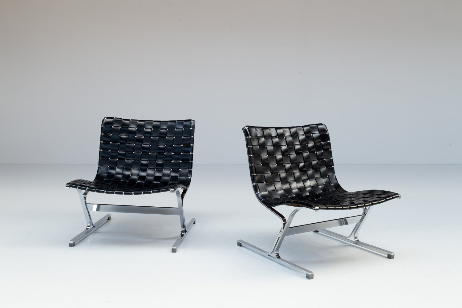 Pair of black leather 'Luar' chairs by Ross Litell