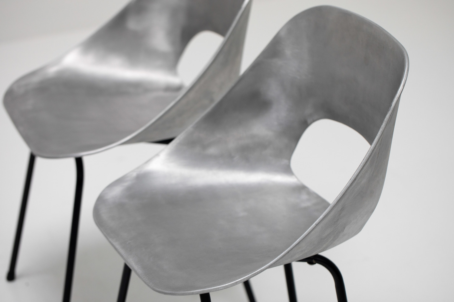 Aluminium chairs by Pierre Guariche